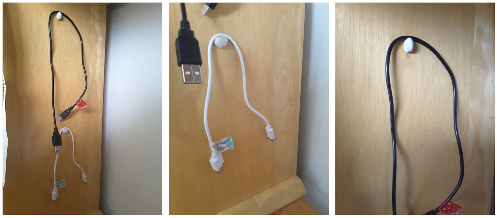 Various cables hanging on blu tack hooks
