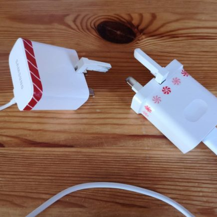 Two chargers with washi tape wrapped around them