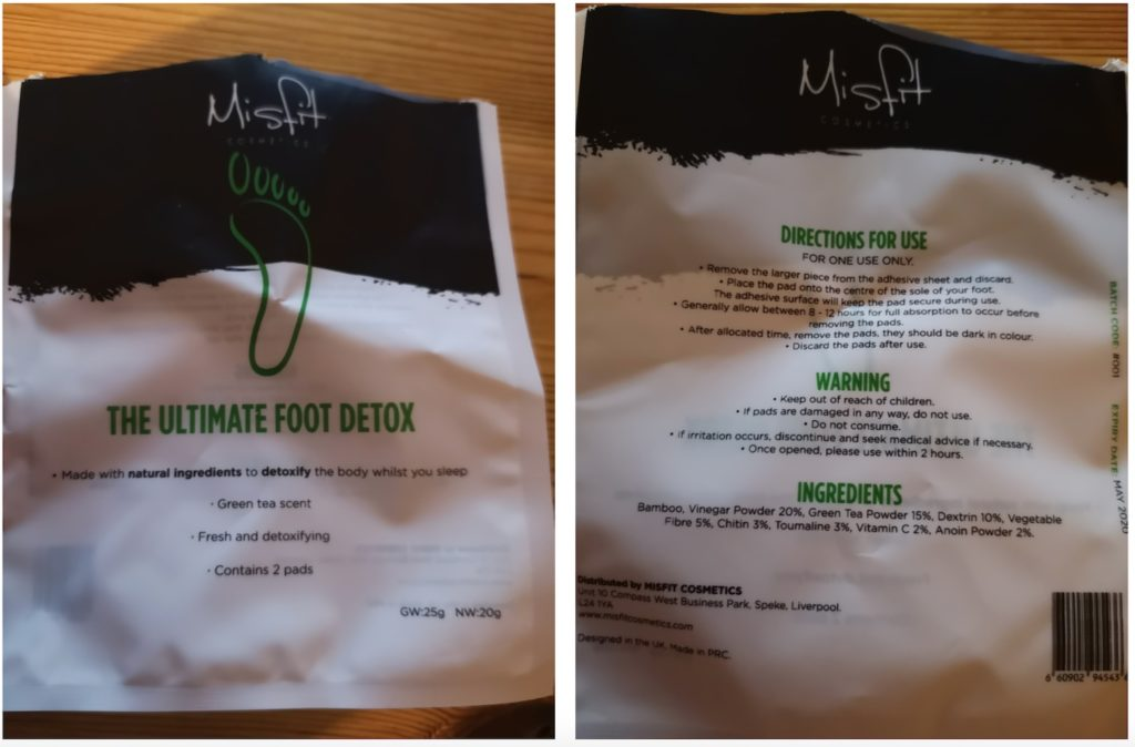 The front and back of an open packet of Misfit Cosmetics detox foot pads, showing the directions for use and the ingredients.