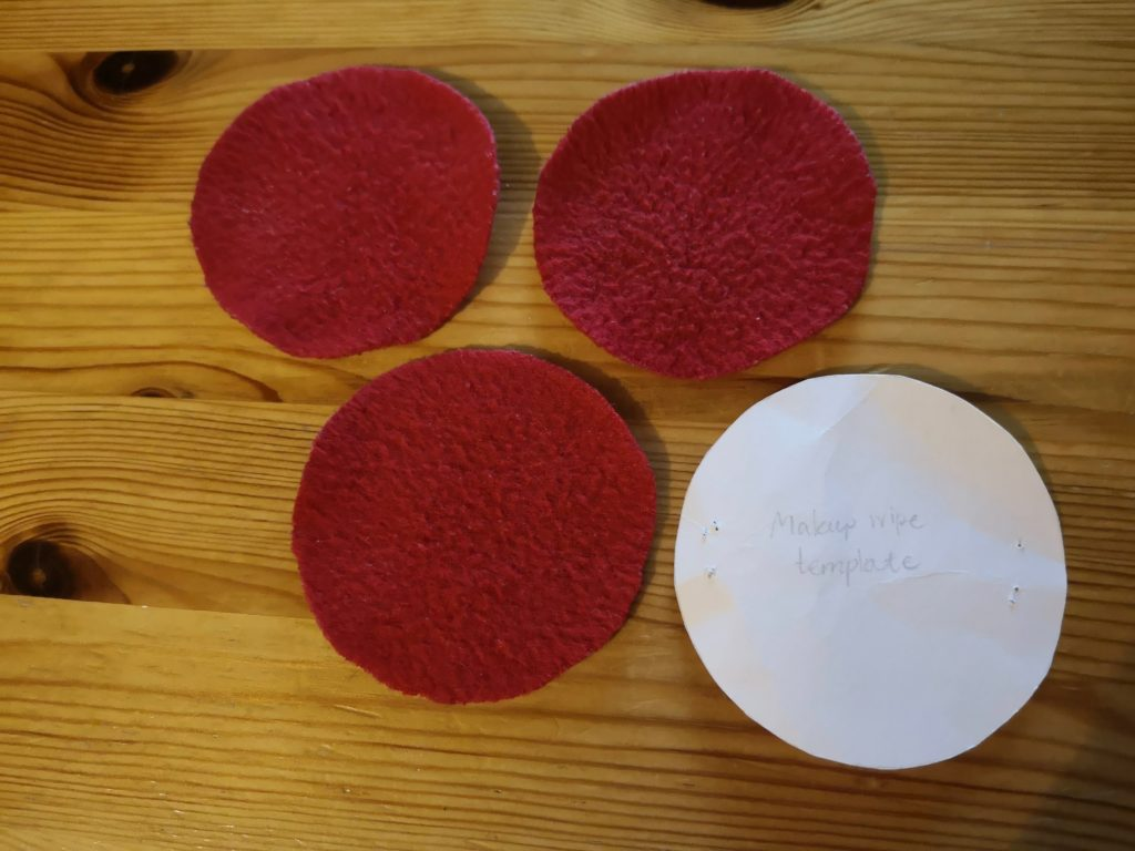 3 homemade reusable make-up wipes, next to the template I used.