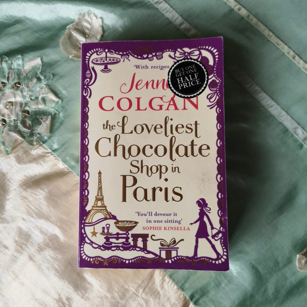 Paperback copy of The Loveliest Chocolate Shop in Paris by Jenny Colgan