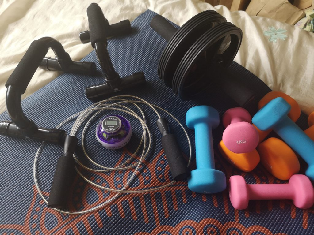 My exercise equipment which includes dumbells, a skipping rope, push-up handles, an ab roller and a Powerball.