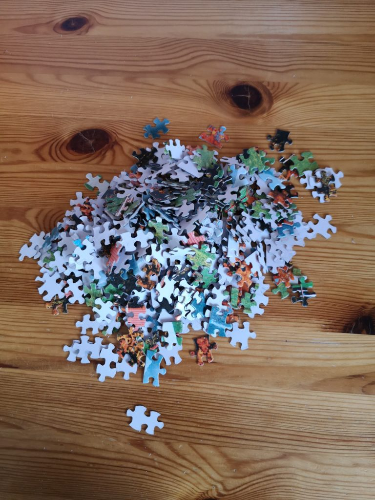 A pile of jigsaw pieces