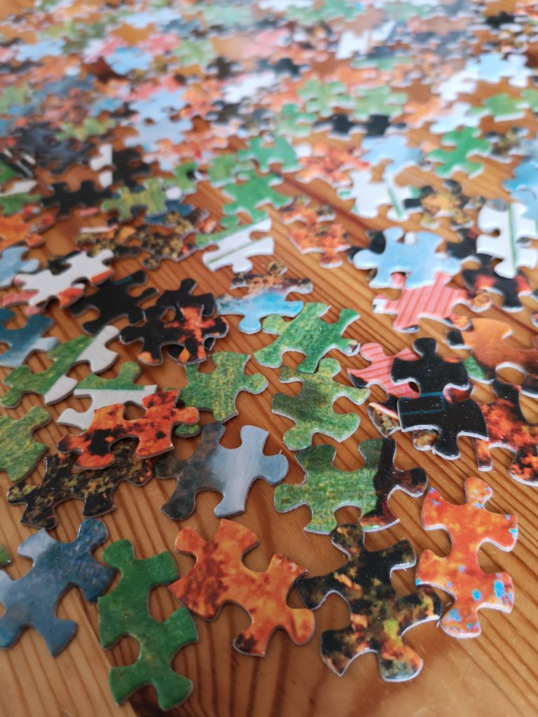 A close up of jigsaw pieces spread out