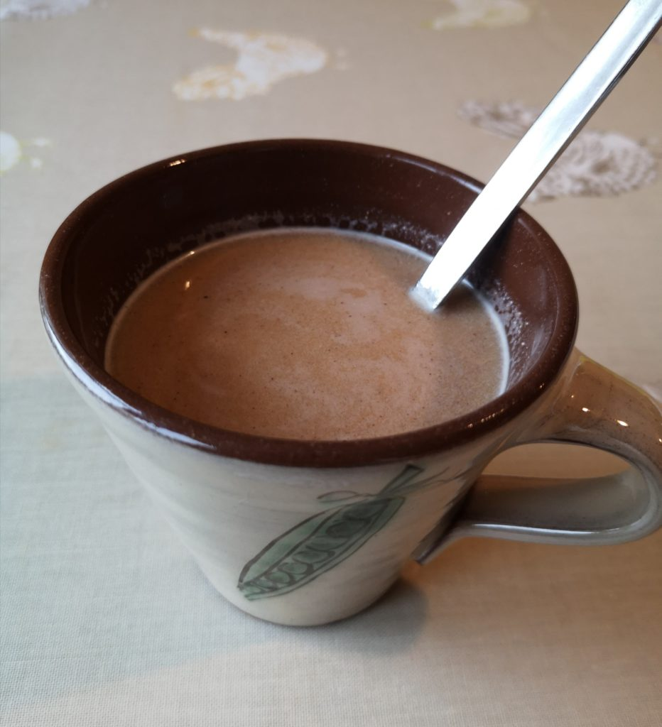 Pumpkin spice 'latte' in a mug with a spoon.