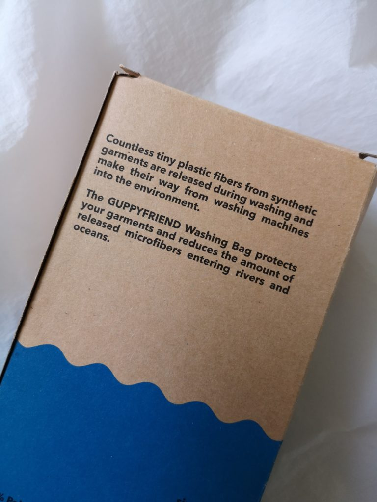 The text on the back of the packaging of the Guppyfriend Washing Bag