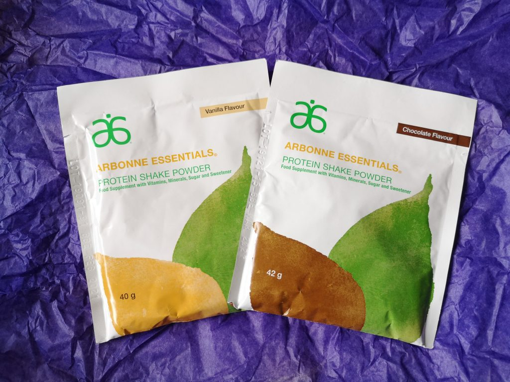 Arbonne Essentials Protein Shake Powders in Chocolate and Vanilla flavours.