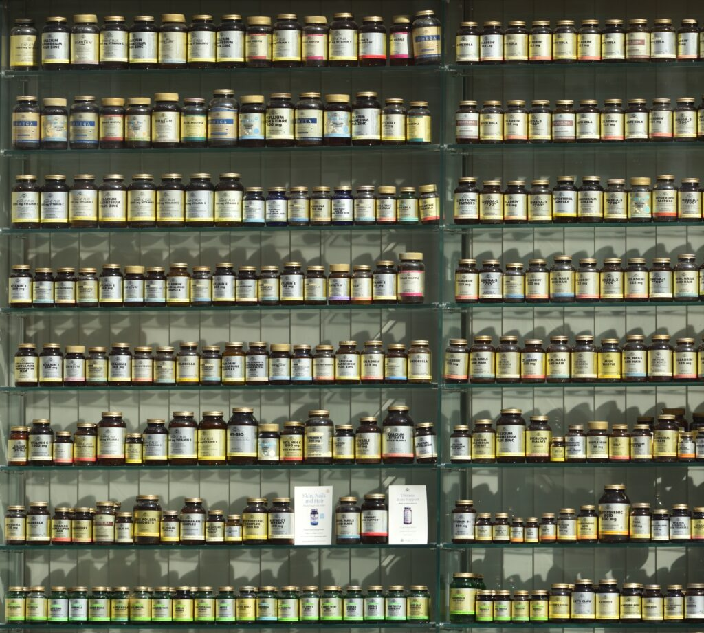 Shelves containing hundreds of bottles of vitamin and mineral supplements