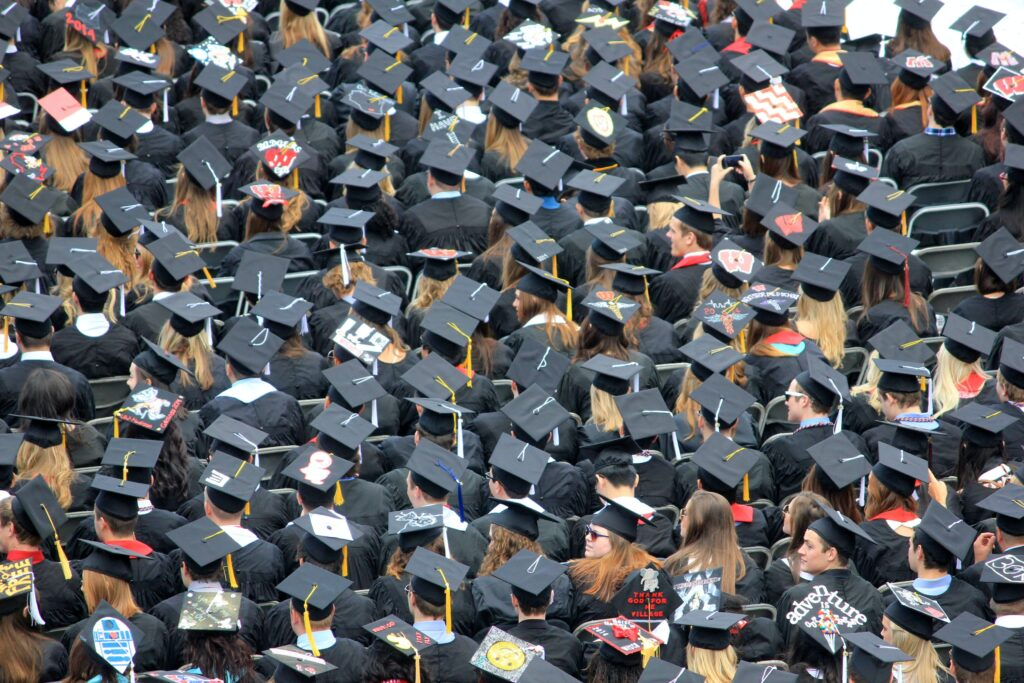 An aerial view of a crowd of students wearing graduation caps.