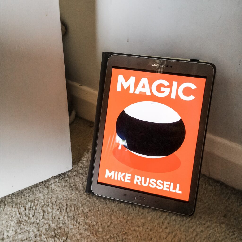 The cover of Magic by Mike Russell, shown on my tablet which is propped up against a wall