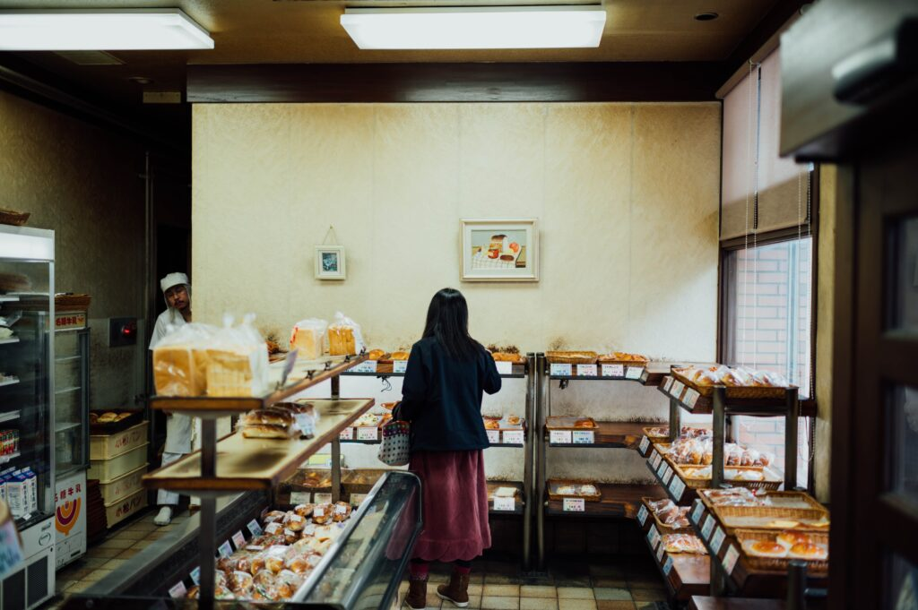 A woman browsing in a bakery.