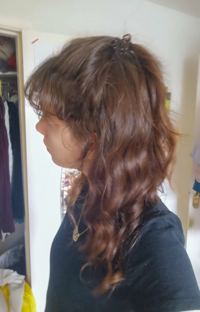 A side view of my curly hair.