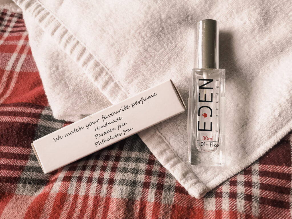 A bottle of Eden perfume and the cardboard box it came in, with text reading 'We match your favourite perfume'.