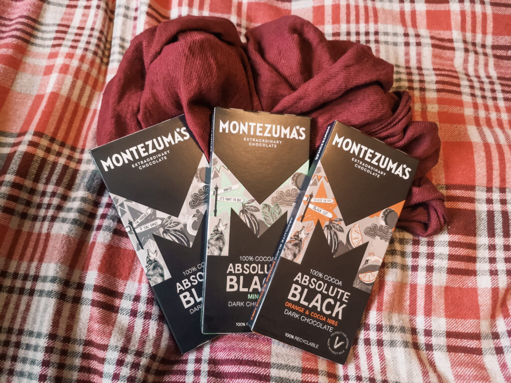 Three different flavours of Montezumas Absolute Black 100% dark chocolate.