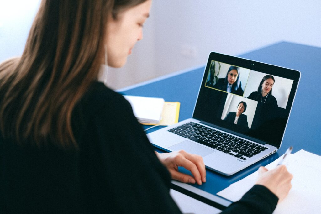 A woman on a business video call on her laptop.