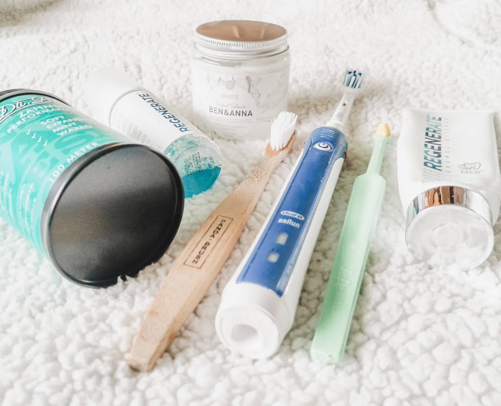 A selection of dental care products including toothbrushes, toothpaste, mouthwash and dental floss.