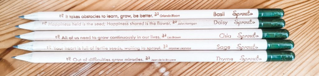 5 plantable pencils which have capsules on the ends containing seeds. They have quotes on them.