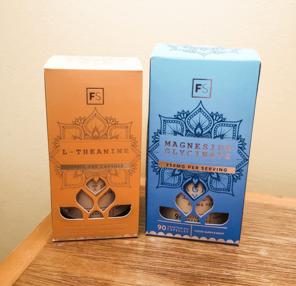 Two cardboard boxes of Focus Supplements - L-Theanine in an orange box and Magnesium Glycinate in a blue box.